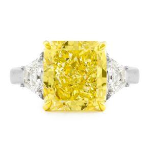 Vivid yellow three stone diamond ring