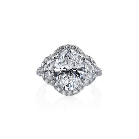 Oval Diamond Three Stone Pave Ring in Platinum
